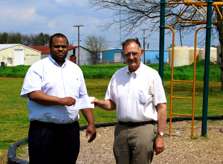 Two men at check presentation outside