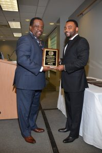 Myron Jackson, President and CEO of the Design Group, presents Southern Bancorp CEO, Darrin Williams, with the Supporting Organization of the Year Award